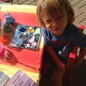 Evan exploring the rainbow science experiment.