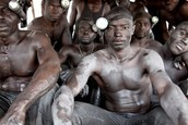 Lisa Kristine captures a photo of men mining gold in Ghana