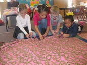 Mrs. Allison's class made baby blankets.