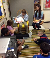 Reading to students in Ms. Trumbetti's class