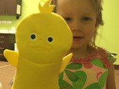 Addie and her duck puppet.