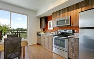 Sleek Modern Kitchens with Stainless Steel, Hardwood Floors & Granite Counters