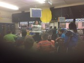Fourth graders responding to a picture from the Civil War era with Ms. Cole in fourth grade.