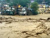 A view of flooded Mandakini river in Chamoli district on Tuesday followed by heavy rains in Uttarakhand. (PTI)