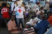 Red Cross giving First aid