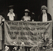 Women holding up one of Susan B. Anthony's quotes