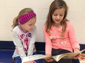 Lily reading to her buddy