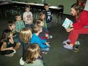 Kids enjoying Mrs. Lenzen's reading.