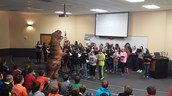 Guest choir conductor T-Rex
