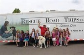Greg with a Girl Scout troup in front of his transport truck