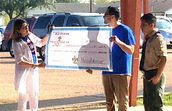 Manny Presents the Check to Saenz Elementary