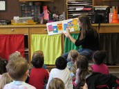 "Evaleigh's mom Jacinda reading ""Planting a Rainbow"" to our class"