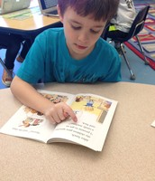 Nathan reading about a new student becoming the class president.