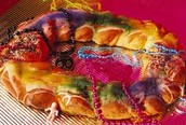 King Cake w/ hidden baby and beads.