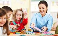 Teacher with pre-school age children