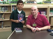 Lou autographs books for some lucky students (Franky Santoy pictured)