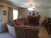 Large family room with wetbar and a fire place