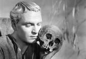 Hamlet holding a skull.