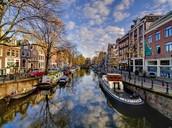 1) Travel to Amsterdam