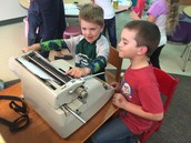 Playing with Mrs. Larkins' mom's typewriter