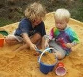 Kids being creative in a sandbox