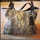 Switch bag in Snake print $74