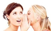 Two Girls Talking Aside