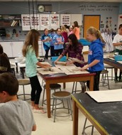 5th graders working with clay