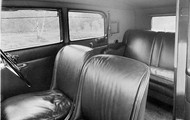 The black car seats with a leather out look