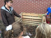Mrs. Noe explains what can and cannot go into a compost bin.