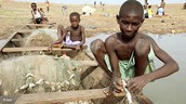 Young boys enslaved in a fishing village