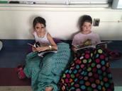 Fiona and Catherine Enjoying Books
