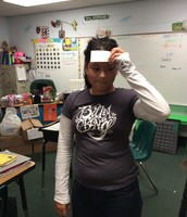 Mrs. Hopkin's students review vocab by playing heads up.