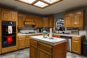 great open kitchen with island and built ins for more storage