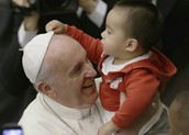 Pope Francis with a child