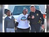Police officer helps determined runner finish her race