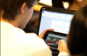 Laptops in Class: Helpful or Harmful?