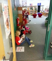 Third graders with new books from the library