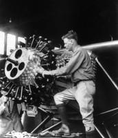 Charles Lindbergh working on plane engine