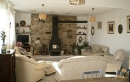 Spacious sitting room with good sized log burning stove