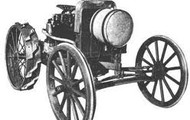 One of the first tractors invented by John.