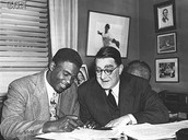 Jackie Robinson Signing his contract