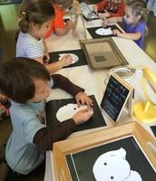 Mila, Arlo, Juliette and Finn starting their black and white art