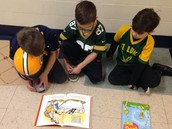 Joe and Marcus matched their kindergartener as they read