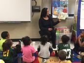 Mrs. Maddox reading to Mrs. Myers' Classroom