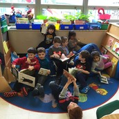 Togetherness after snack in the classroom library!