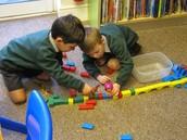 Boys make a bridge for their Billy Goats Gruff
