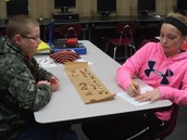 Designing and trying out our Mancala boards.
