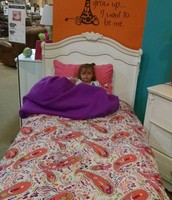 """At the furniture store while we looked for bedroom sets.  Quincy chose this """"big girl bed."""""""