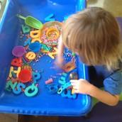 Evan sorting colored beans